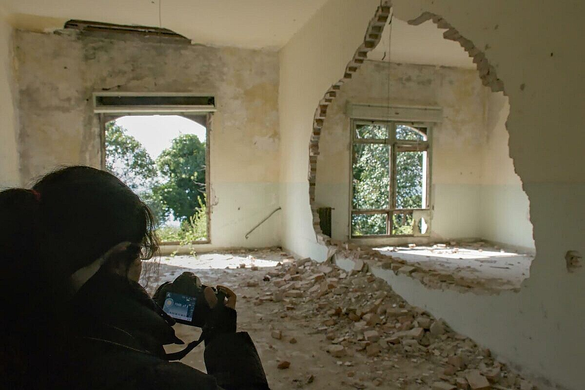 Collapsed walls in the abandoned hospital on Poveglia
