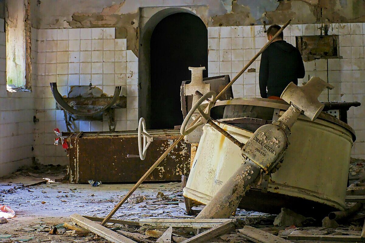 The vandalised central kitchen of the abandoned hospital on Poveglia